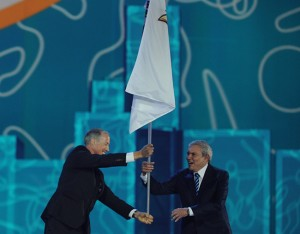 Mayor of Lima, Luis Castaneda Lossio (R)  receives  the flag of PASO (ODEPA in spanish) during the closing ceremony for the 2015 Pan American Games at the Rogers Centre in Toronto, Ontario, on July 26, 2015. Lima will be  hosting the next  Pan American Games in 2019. AFP PHOTO / HECTOR RETAMAL