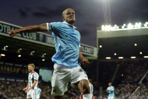 Manchester City's Belgian defender Vincent Kompany celebrates after scoring City's third goal during the English Premier League football match between West Bromwich Albion and Manchester City at The Hawthorns in West Bromwich, central England, on August 10, 2015. AFP PHOTO / OLI SCARFF RESTRICTED TO EDITORIAL USE. No use with unauthorized audio, video, data, fixture lists, club/league logos or 'live' services. Online in-match use limited to 75 images, no video emulation. No use in betting, games or single club/league/player publications.