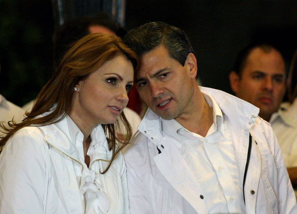 Mexican presidential candidate Enrique Pena Nieto (R) from the Institutional Revolutionary Party (PRI), speaks with his wife Angelica Rivera during the start of his presidential campaign, at Guadalajara square esplanade in Guadalajara, state of Jalisco, early on March 30, 2012. Mexico will hold presidential elections next July 1, 2012.   AFP PHOTO/Hector Guerrero (Photo credit should read HECTOR GUERRERO/AFP/Getty Images) ORG XMIT: