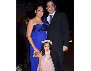 Melanie de Reina, Paulina Reina y Jorge Arturo Reina.